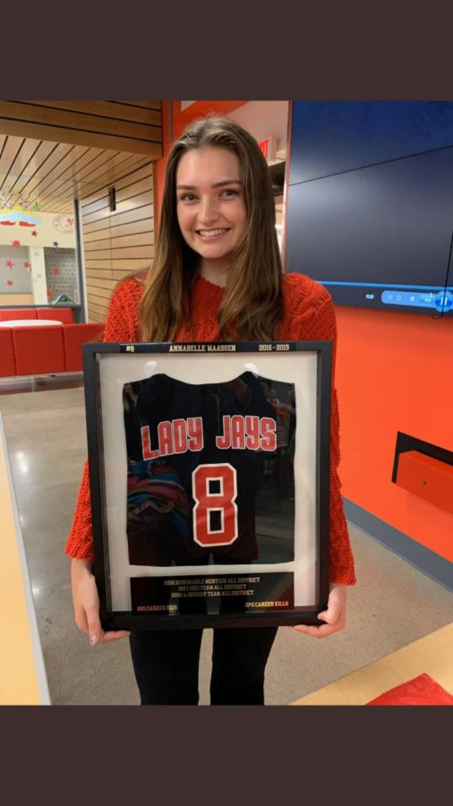 Annabelle Maassen posing with her retired jersey.